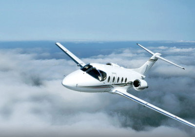 Beechjet 400A, Beechcraft private jet, charter flight above clouds